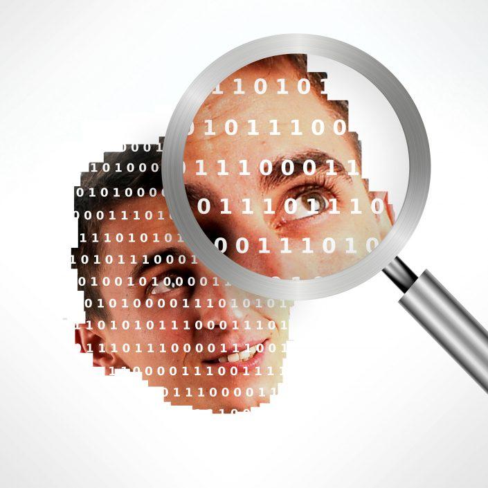 loupe sur une photo avec un visage avec du code binaire